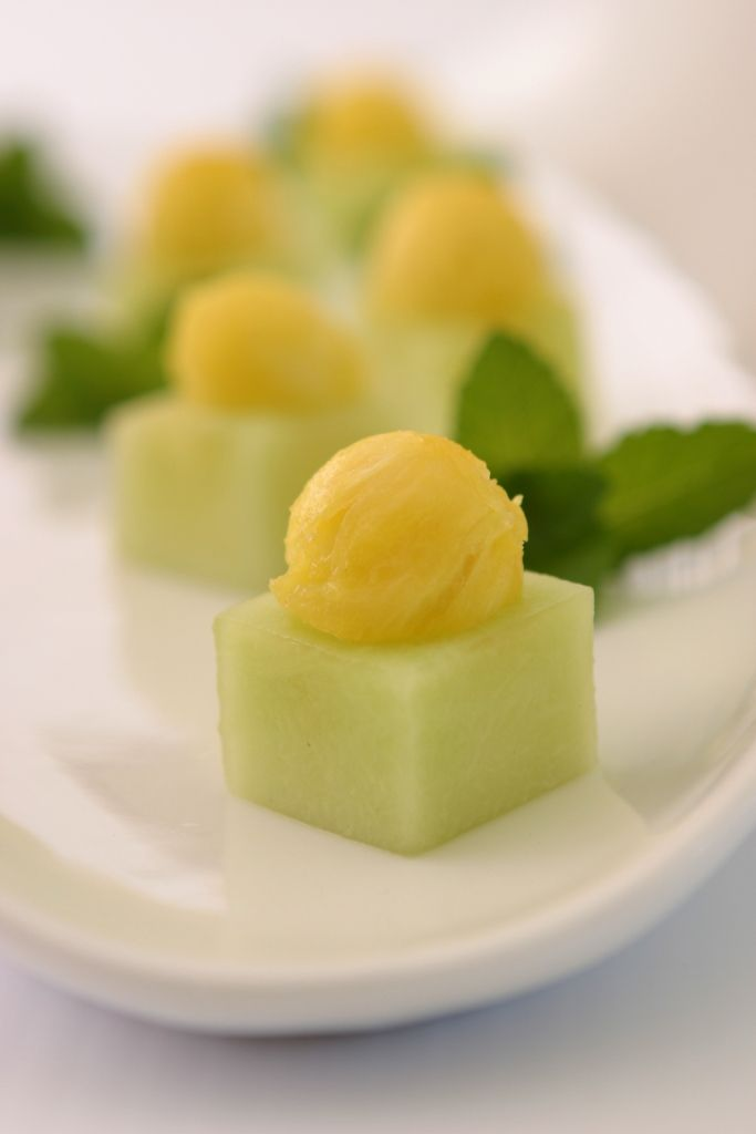 Winter melon cups filled with pineapple. Healthy dessert canape