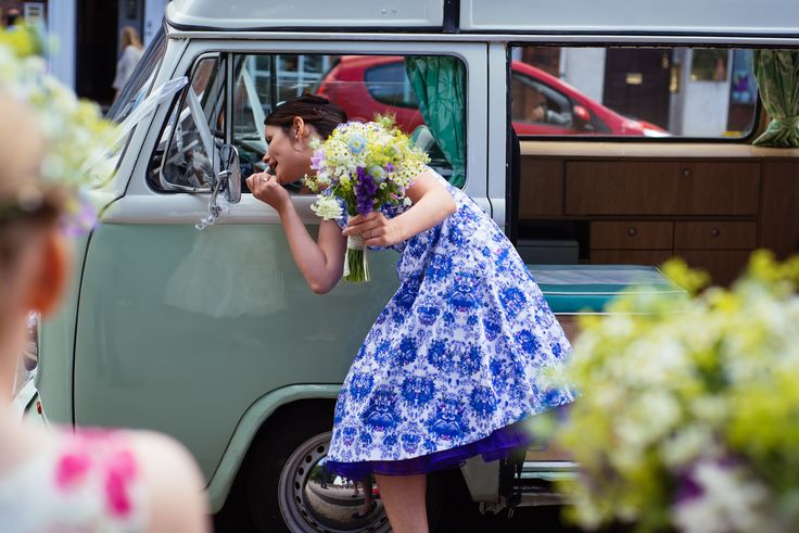A bridesmaid does her makeup in Betsy's mirror