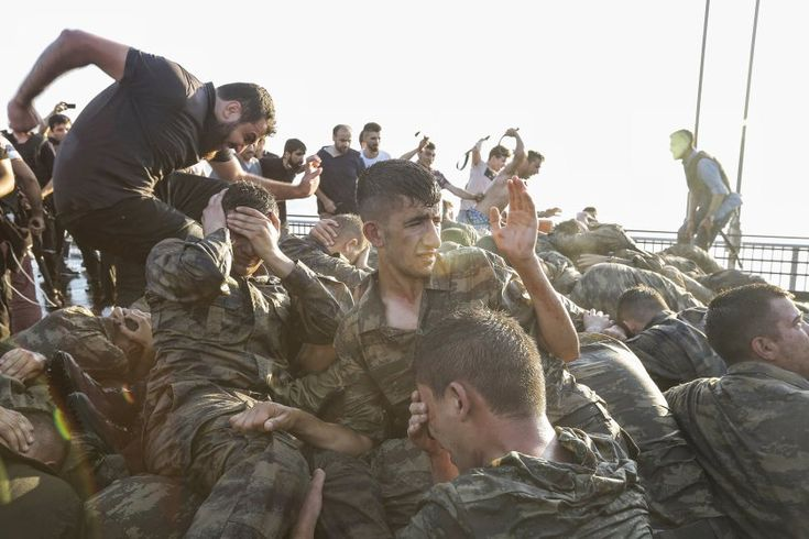 Soldiers involved in the coup attempt surrender on  Bosphorus bridge in Istanbul, Turkey, on July 16, 2016.