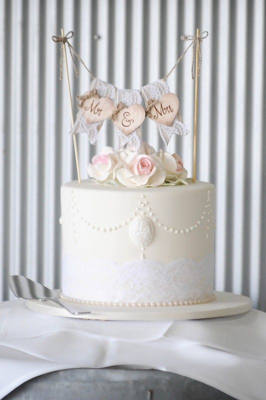 Wedding cake with vintage wooden lace topper captured by Ateia Photography & Video at Yarra Ranges Estate. Winery Wedding | Yarra Valley Wedding | Dandenong Ranges Wedding