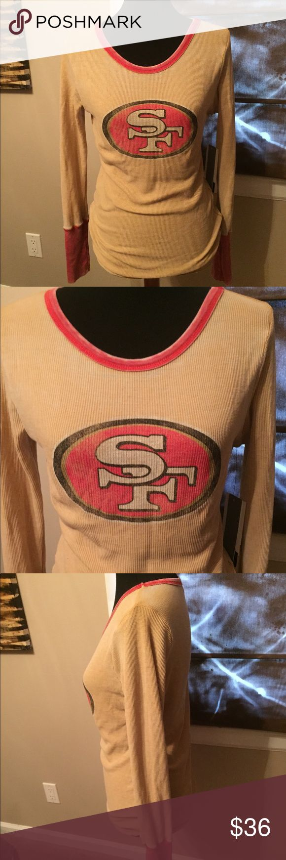 NWT San Francisco NFL Thermal Game Day Shirt Never been worn. Size medium. Color is a deep cream/tan base. Team logo on the front. Size is medium. Long sleeve. Round neck. NFL Tops