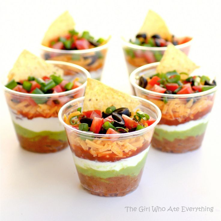 Individual Seven Layer Dips - I love that these are individual. Nothin' uglier than a spoonful of this stuff on your plate by itself! ;)
