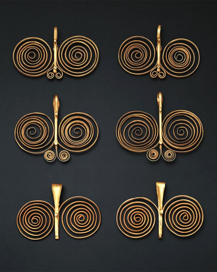 Indonesia ~ South Nias   Double spiral ear ornaments ~ fondulu ~ gold   19th century    These are worn singularly by men and in pairs by women    Source: 'Gold Jewellery of the Indonesian Archipelago'; page 415