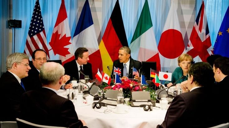 G-7 chiefs kick off Alpine summit by taking tough stance toward Russia, rule out 'Grexit' -  U.S. President Barack Obama and German Chancellor Angela Merkel attend a working dinner at the G-7 summit at the hotel castle Elmau in Kruen, Germany, Sunday. Leaders from the Group of Seven industri...