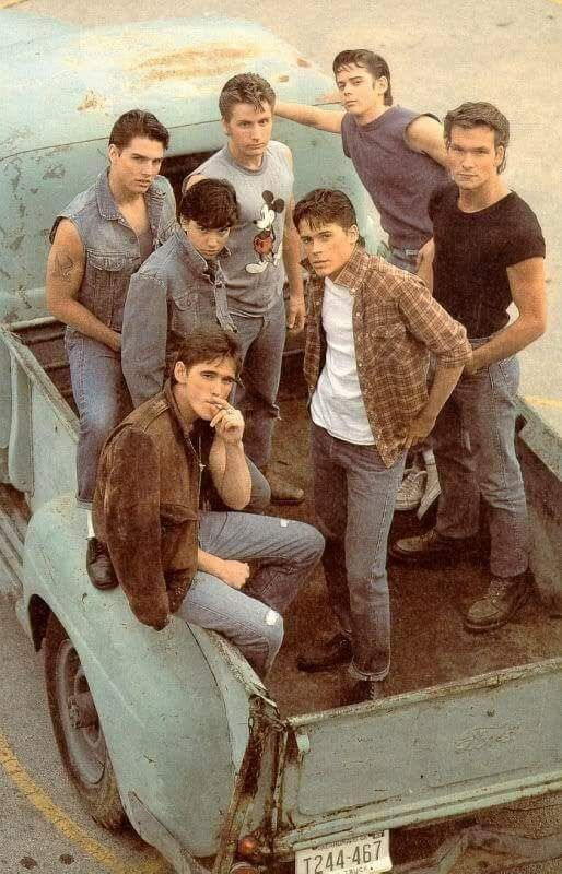 Tom Cruise, Emilio Estevez, C. Thomas Howell, Patrick Swayze, Ralph Macchio, Rob Lowe and Matt Dillon in 1983 set of The Outsiders
