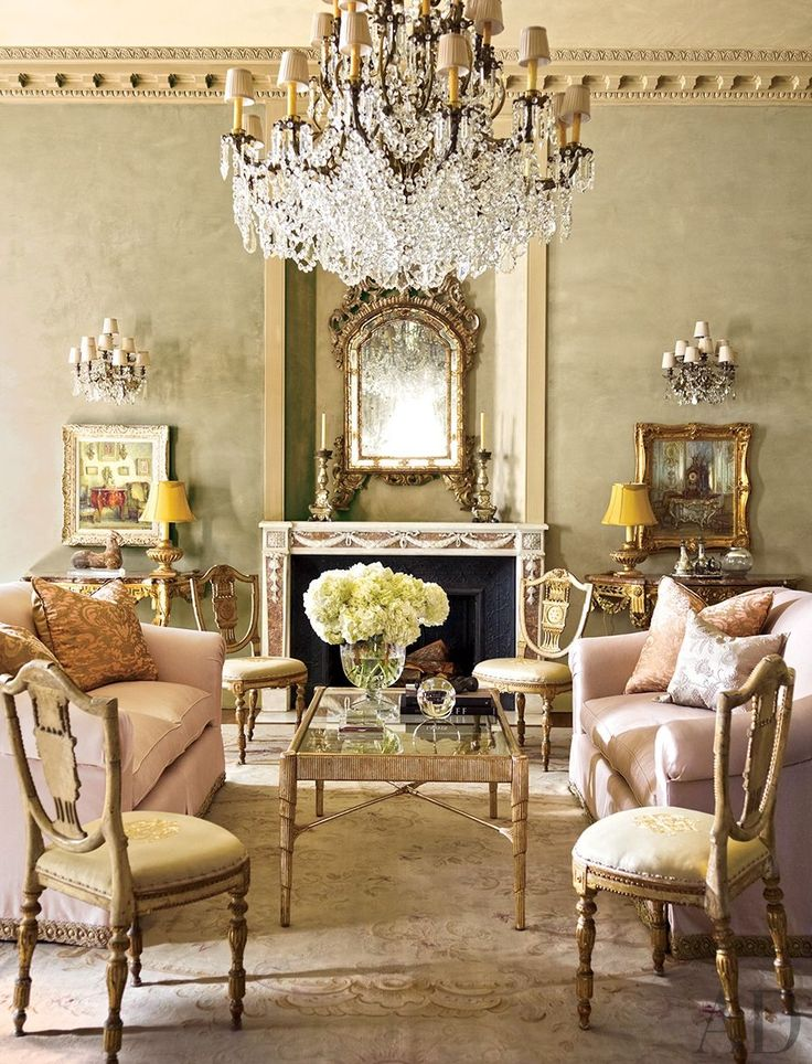 Pretty and Posh! French chic living room with gold, pastel furniture, and stunning crystal chandelier!