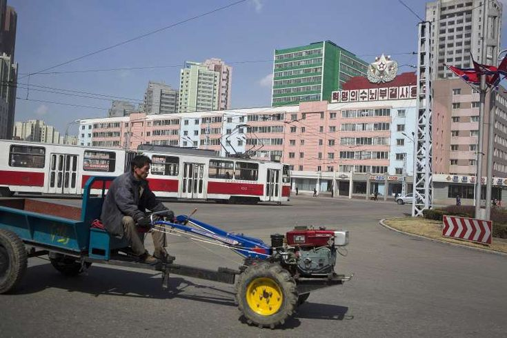 North Korean man drives a small tractor in central Pyongyang, North Korea.