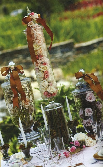 I love this beautiful apothocary idea!  Not just for a wedding but isn't the centerpiece idea nice?