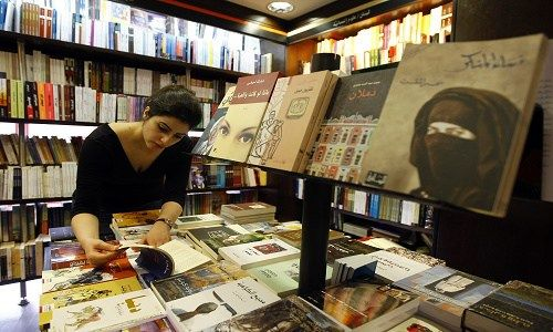 """A Lebanese university student browses an Arabic novel at a bookshop in Beirut on April 21, 2009. Beirut is to be nominated on April 23 as UNESCO """"World Book Capital for the year 2009"""", at a time when the production of novels is booming in the Arab world, breaking taboos and prohibitions, but sorely missing readers. AFP PHOTO/JOSEPH BARRAK / AFP PHOTO / JOSEPH BARRAK"""