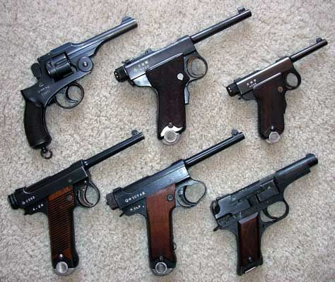 Top row: Type 26 revolver, Papa Nambu, Baby Nambu - Bottom row: small and large trigger guard Type 14 pistols and a late wooden slab-grip Type 94