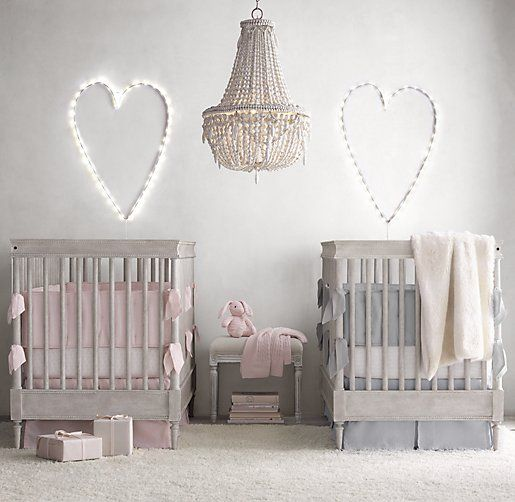 A twin nursery featuring the Airin Spindle Crib from Restoration Hardware is so pretty and perfectly suited to a baby boy and a girl!