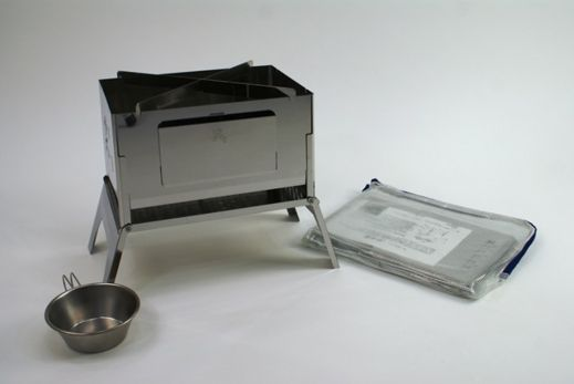 My portable grill by Sho's. It has a footprint approximately the same as a sheet of A4 paper. It stores flat in a vinyl sleeve and is less than an inch thick.