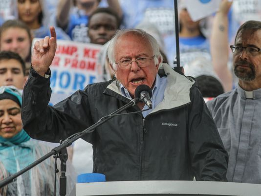 Sen. Bernie Sanders called on Indianapolis to hold President Donald Trump accountable Monday evening at a rainy jobs rally downtown.