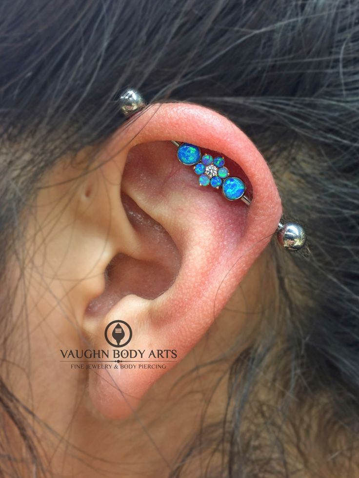 We did this industrial piercing for Josephine almost a year ago and she is healing up wonderfully. She stopped in tonight to change up the gem combination in her @anatometal barbell. She picked up this lovely 18k rose gold flower with dark blue opals. Great choice, Josephine. Your ear looks fantastic! @vaughnbodyartsMonterey, CA