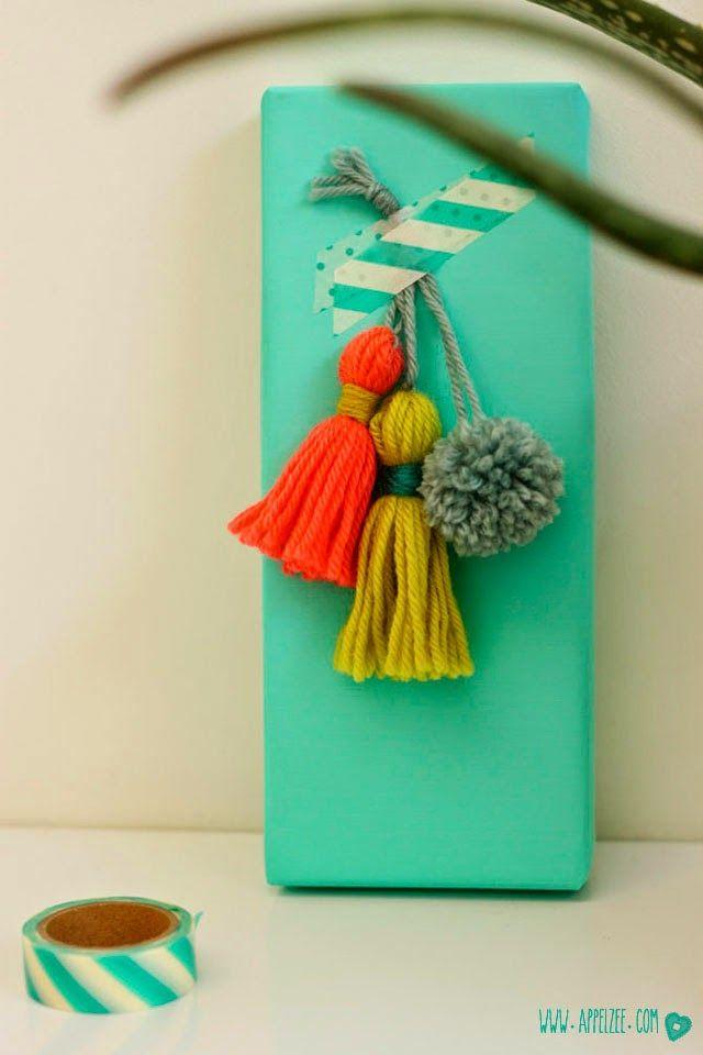 tassels and pom pom giftwrap