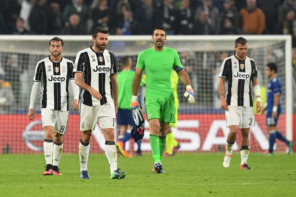 Andrea Barzagli (2nd L) of Juventus with his team mates shows his dejction at the end of the UEFA Champions League Group H match between Juventus and Olympique Lyonnais at Juventus Stadium on November 2, 2016 in Turin, Italy.