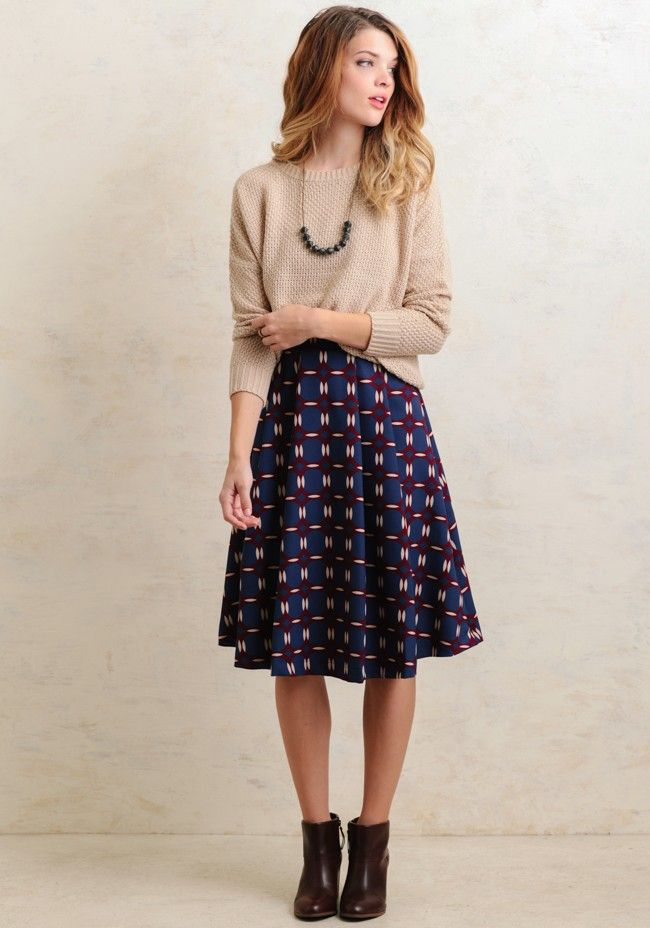 Create a cute, retro-inspired look with this burgundy and teal circle-printed skirt with cream accents. Designed with an A-line silhouette and box pleating at the waistband for a sweet and flowy ...