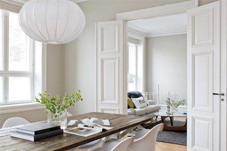 suelo de madera de roble espigado decoración sillas knoll sillas eames salón con chimeneas decoración rodapies altos decoración paredes gris...