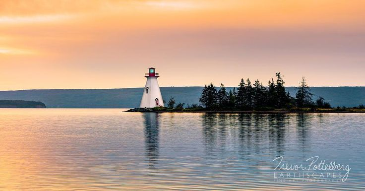 """""""Kidston Island Lighthouse"""" - Order # 633 - was captured at dawn on the gorgeous Bras d'Or Lakes. The island is uninhabited and owned by the Village of Baddeck in Nova Scotia.  This beautiful structure was built in 1912 and still sends out an active beacon to this very day.  Enjoy!"""