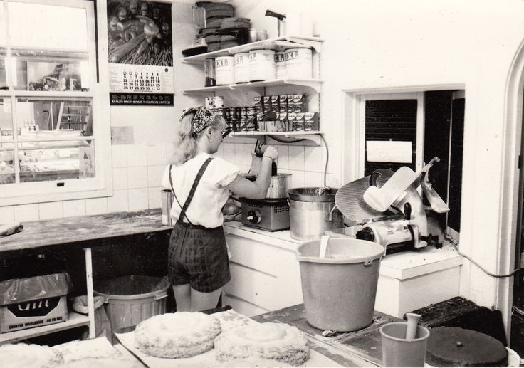 1971 1st Store - Creating gorgeous food for our customers in this very small kitchen - note, hotpants as uniform!