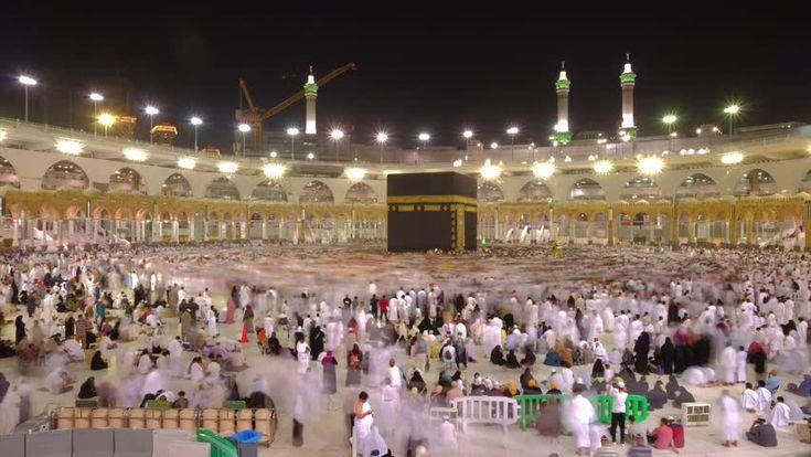 Mecca, Saudi Arabia - CIRCA September, 2017: Time lapse video of Muslim pilgrims circling around the holy Kaaba at night during Hajj inside al Masjid al Haram in Mecca, Saudi Arabia. Camera static.