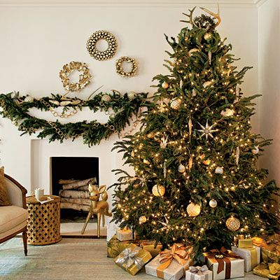 The theme of this tree is colors of silver and gold, basically neutral but with a little bling. Glittered ornaments and mercury glass balls lend a glimmering, glamorous feeling. Skip the tree skirt for a clean and simple look, and to let the lower limbs of the tree brush the floor. Place packages around the outside of the tree to make it look larger.