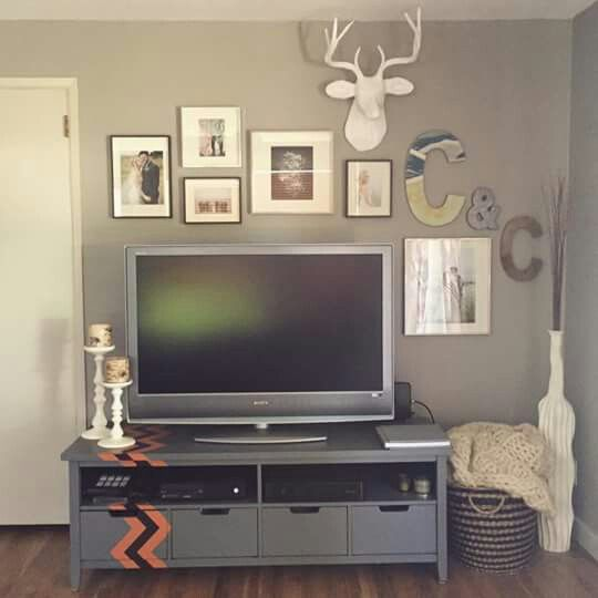 Gallery wall above tv. West elm deer bust                                                                                                                                                                                 More