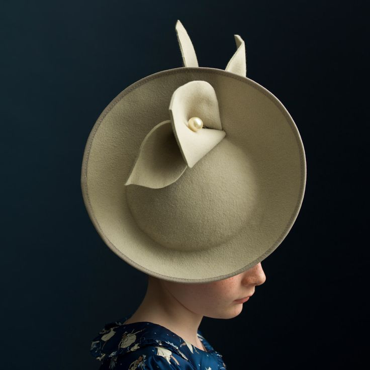 Stone saucer with pearl. Handmade felt hat by fifilabelle, London. Photo by Julia Boggio. www.fifilabelle.com