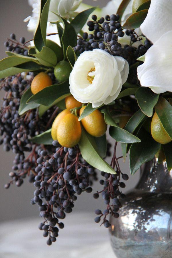 Winter floral centerpiece -- white ranunculus, privet berry,  kumquats.