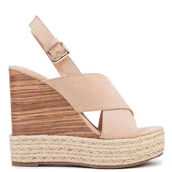 Beige platform with suede texture and crossed straps. Features wedge covered with imitation wood and rope. Fastens with adjustable ankle strap.