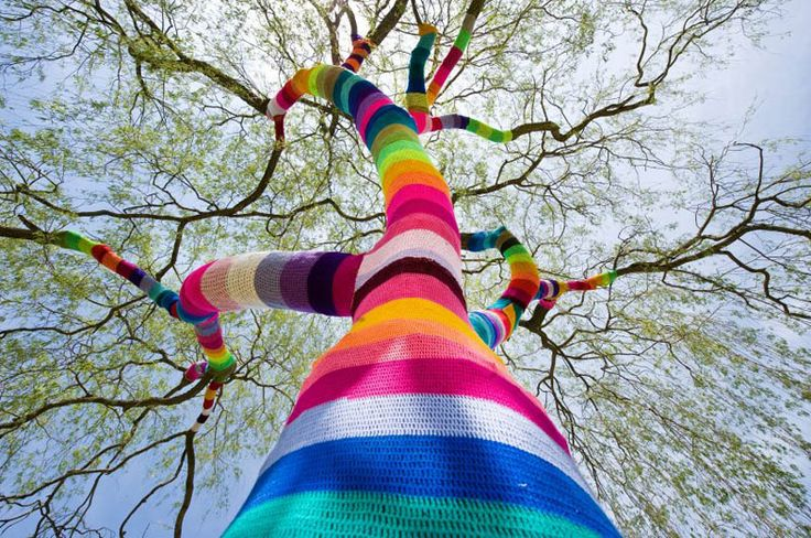 "Ute Lennartz-Lembeck knit this rainbow sweater for a weeping willow in the German town of Velbert. She is one of many Germans caught up in the global craze of ""yarn bombing,"" installing colorful yarn creations in urban spaces.: Yarn Bombing, Color, Yarns, Street Art, Trees, Yarnbombing, Rainbow, Streetart"