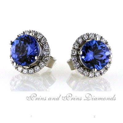 18ct white gold handcrafted tanzanite and diamond halo earrings. 2x 0.80ct round brilliant cut tanzanites are set with a surrounding halo of pave set diamonds. The total diamond weight is 0.40ct G/H VS/SI.  Order time for these earrings is 10 working days. We can custom create the perfect pair for you with the tanzanite sizes of your choice.