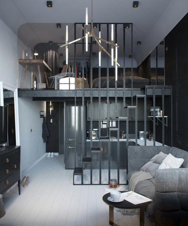 Перегородка между кухней и гостиной служит поручнем для лестницы ведущей на второй уровень. .