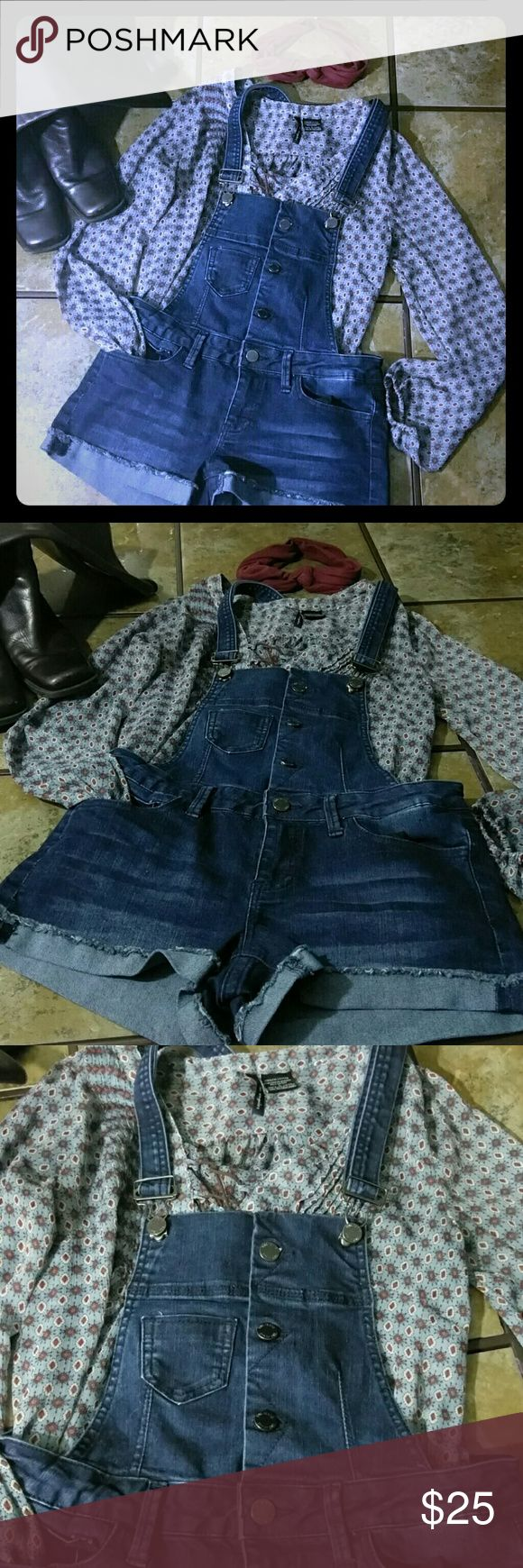 "Denim Jumper shorts Size ""5"" juniors, similar to xs-small women's size Dark colored jean By Ymi jeans Straps unfasten and are adjustable in length  Buttons down the front are functional Functional front and back pockets Belt loops for further adjustments"