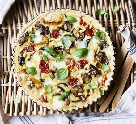 Roasted ratatouille & goat's cheese tart. Packed with oven-roasted aubergines, courgettes, peppers and onions, this tart makes a great centrepiece for a picnic or al fresco lunch