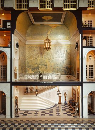 Queen Mary's Dollhouse - The two Halls, with the Grand Staircase, its walls painted by William Nicholson, flanked by servants' quarters