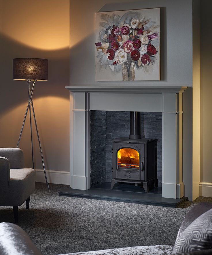 Winterfold Mantel in Blenheim Grey with a Sigma 490 Multi-Fuel Stove inside a Riven Slate Chamber.