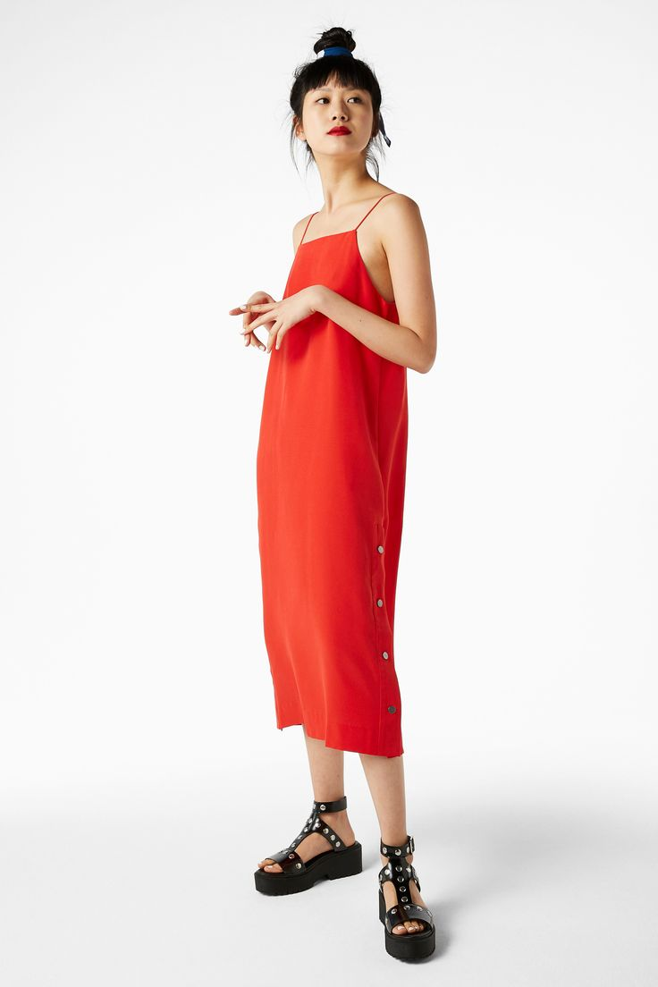 Snaps for u. A long, luxe slip dress that you can adjust on the press-snap placket sides. Superskinny straps.