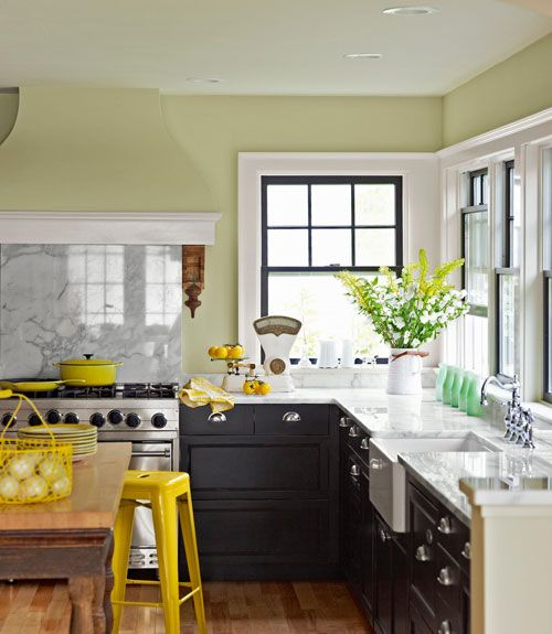 A Pop of Yellow Italian marble tops the kitchen's custom cabinetry, while salvaged Victorian corbels serve as distinctive brackets for the stove's hood. An industrial steel stool gives the otherwise neutral room a jolt of bright color. Read more: Kitchen Decorating Pictures - Decorating Ideas for Kitchen - Country Living