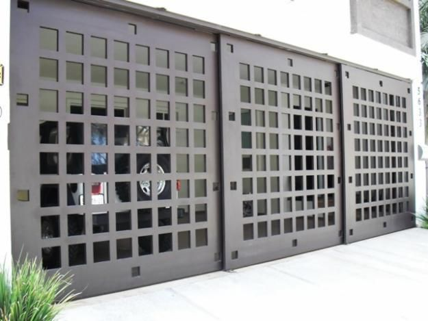 Contemporary Garage Doors - Gates Stainless steel garage door, perfect for contemporary style houses www.garagedoor4less.com