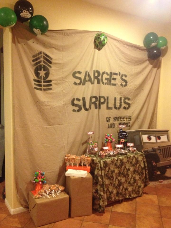 Sarge's Surplus of Sweets and Swag -- I made the sign using Stencils I had on hand, though I designed the badge myself. Just black spray paint on a inexpensive bed sheet. Found the camo throw blanket for 2.99. The Sart standing poster was a little expensive, but it looked so good it was worth it. Bought a camo hat and some balloons with tanks on them at Party City.