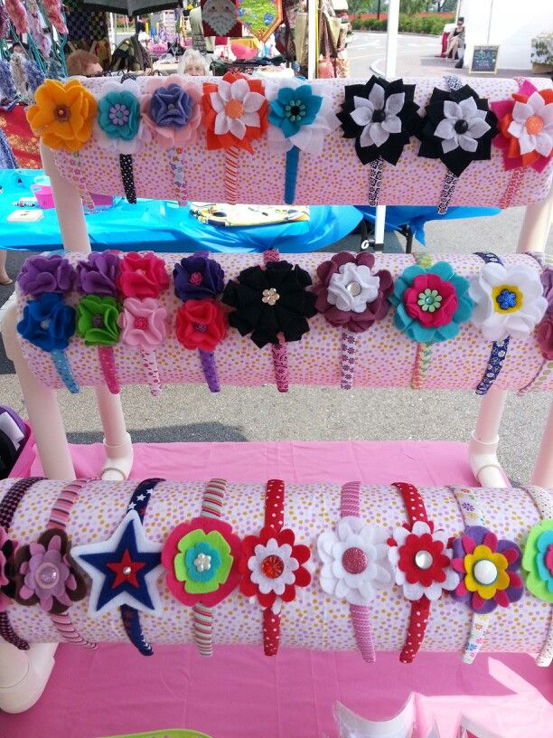Headband display I made for my craft fairs : ).  pvc pipe and paper towels covered with fabric