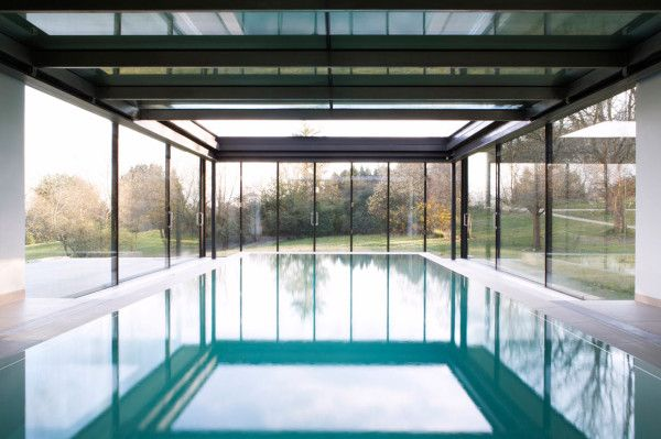 Glass walls and ceiling slide back into the house so that this pool is outdoors when there's nice weather.