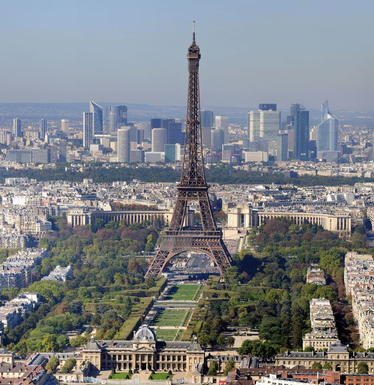 A beautiful view of the Eiffel Tower, Champs de Mars and financial district of Paris.