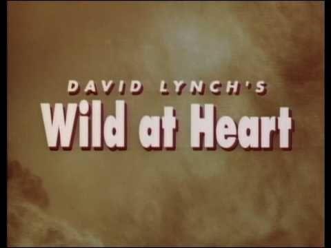 Wild at Heart (1990)  http://www.imdb.com/title/tt0100935/  David Lynch  Nicolas Cage, Laura Dern, Willem Dafoe, J.E. Freeman http://en.wikipedia.org/wiki/Wild_at_Heart_(film)