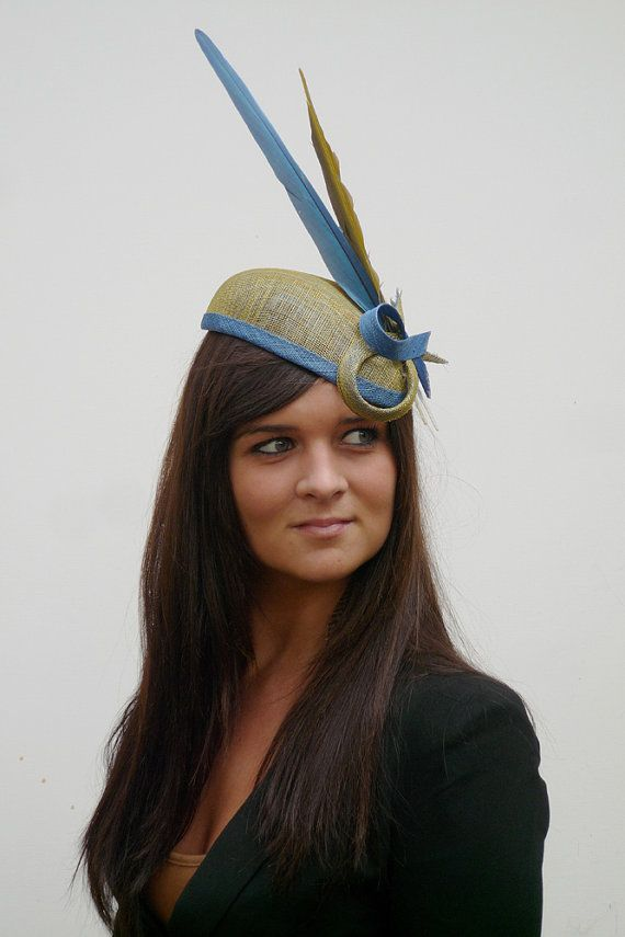I love hats...and British and Dutch high fashion. Definitely would never be able to wear this here...but I love this crazy hat.
