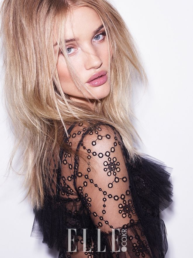 Model Rosie Huntington-Whiteley wears her hair in messy waves with Burberry dress  Photographer Naj Jamai