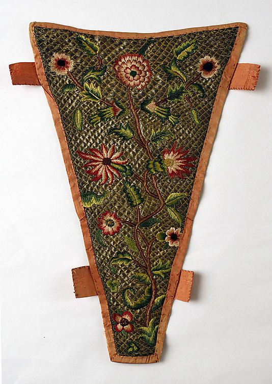 1720s British Stomacher at the Metropolitan Museum of Art, New York - The tabs along the sides allowed the stomacher to be pinned to the gown. The different pieces of a woman's dress were held together with straight pins, but chances of being pricked by them were low as there were still the stays and chemise between the dress and the skin.