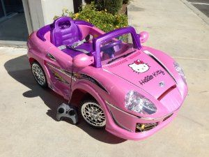 hello kitty kids ride on toy car with remote control free custom name decal childrens powered ride ons toys games