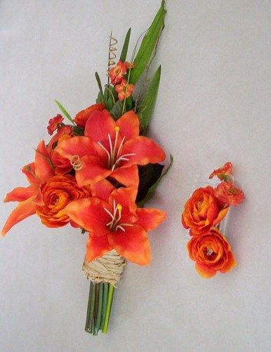 Such a realistic bouquet........careful........you may want to water it!!  Made in Michigan!  Fabulous silk wedding flowers orange bridal bouquet in faux tiger lillies, foliage, accents finished off w